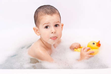 Boy playing in the water with toy photo