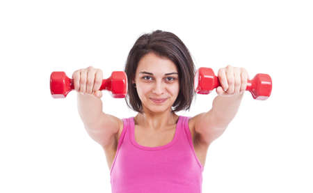 Portrait of pretty young woman lifting dumbbells during exercising Stock Photo - 13651547