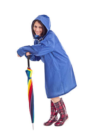Woman in a blue mac with umbrella  photo