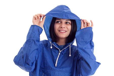 slicker: young women in a blue rain coat is looking up