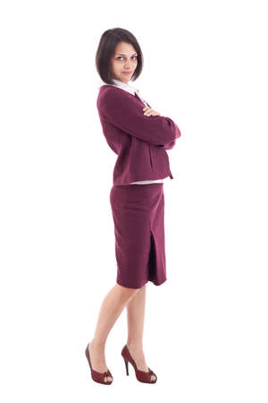 Confident young businesswoman standing arms crossed, looking at camera photo