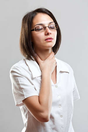 sore throat: Sore throat young woman in gray background Stock Photo