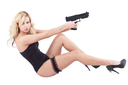 Sexy girl with gun, isolated on white