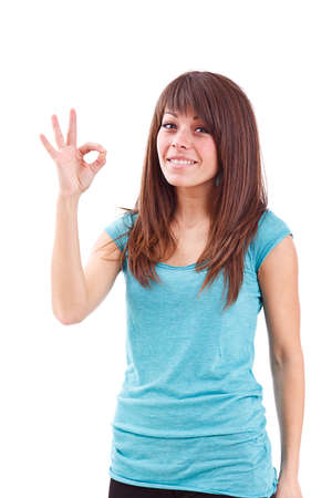Portrait of beautiful young woman gesturing a okay sign on white background Stock Photo - 13683547
