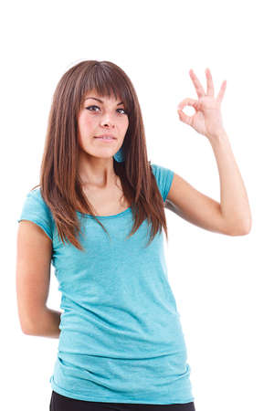 Portrait of beautiful young woman gesturing a okay sign on white background Stock Photo - 13683548