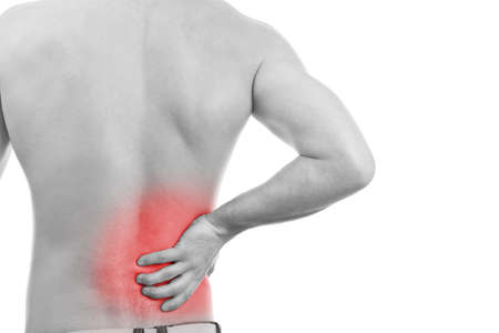 warning back: Rear view of a young male. Holding his back in pain.  Stock Photo