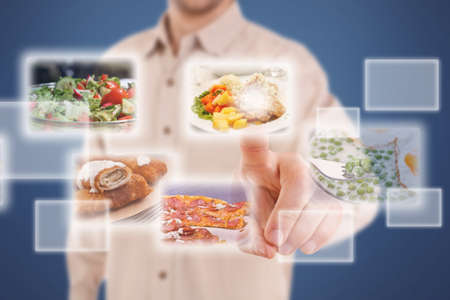 Man pressing a touchscreen button, with food selection  photo