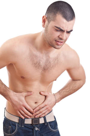 Muscular man holding painful stomach  photo