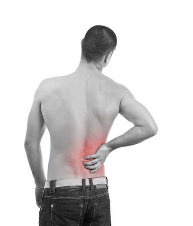 spinal conditions: Young man having a Back pain, monochrome photo with red as a symbol for the hardening  Stock Photo