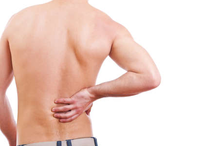 aching muscles: Young man with back pain