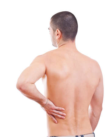 Young man with back pain, isolated in white background photo