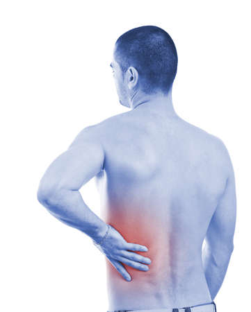 aching muscles: Young man with back pain, isolated in white background, blue photo with red as a symbol for the hardening