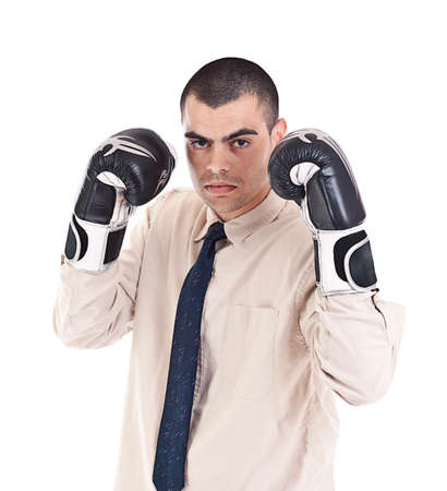 Portrait of a business man wearing boxing-gloves isolated on white  photo