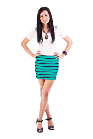 Beautiful woman posing in short skirt. Isolated over white background  photo
