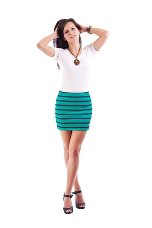 mini skirt: Jeune fille posant en jupe courte. Isol� sur fond blanc