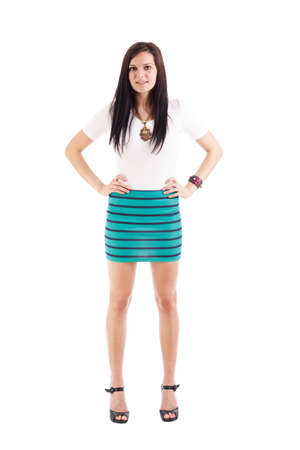 Beautiful young lady posing in short skirt. Isolated over white background  photo