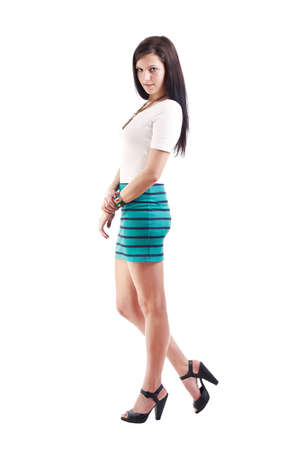 Full length of a beautiful young lady in short skirt photo