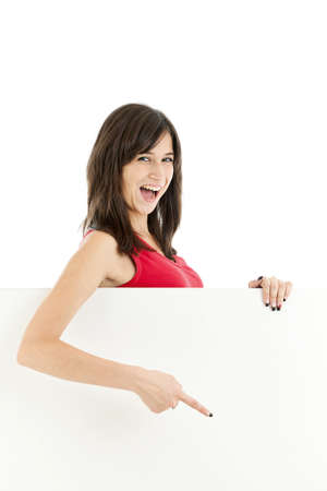 Young happy smile girl pointing her finger at a blank board Stock Photo - 13690181