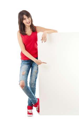 Young girl holding a long vertical white banner over a white background  Stock Photo - 13690178