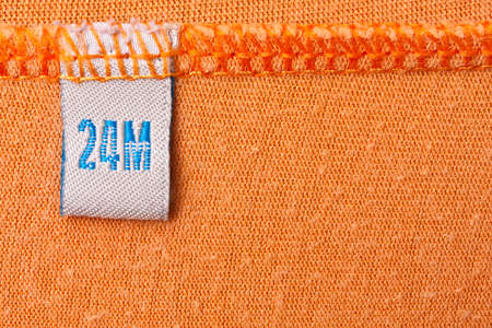 Label size 24 M on orange cloth photo