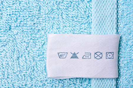 dry cleaned: Label with laundry care symbols Stock Photo