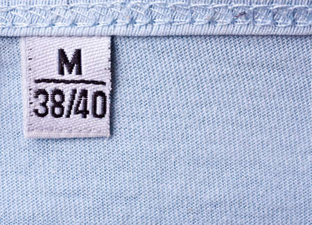 close-up of clothing label with M size photo