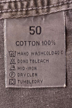 Close up view of a laundry advice clothing tag photo
