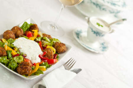 tzatziki: Meatballs with mixed salad and tzatziki sauce Stock Photo