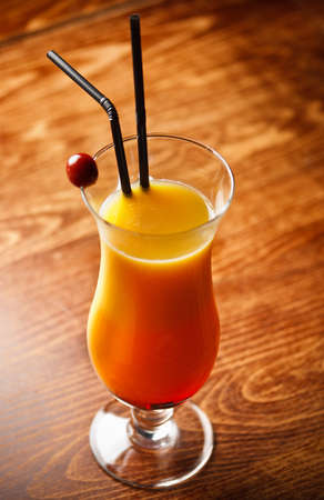 tabel: Cocktail with orange Juice on bar tabel, cherry decoration