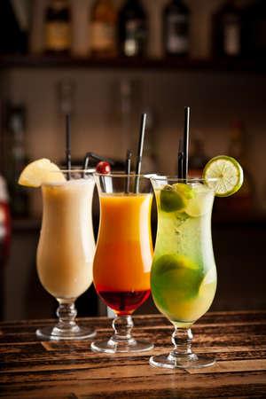 bartending: Three fresh cocktails on a bar table