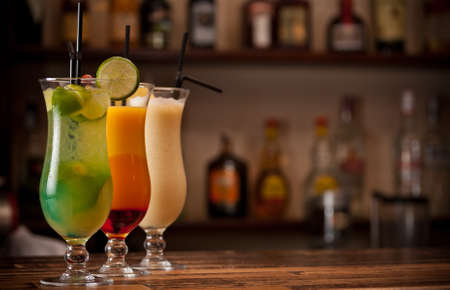 bartending: Three cocktails on a bar table