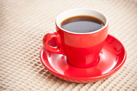 Cup of coffee on beige tablecloth  photo