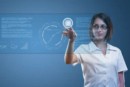 Young serious businesswoman working on modern touch screen Stock Photo - 13923072