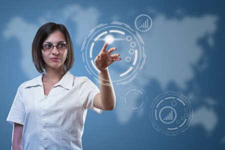 Business woman pointing on sensor screen, high technology concept  photo
