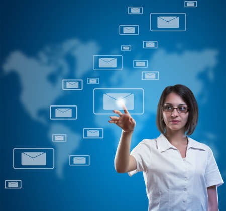 Businesswoman pressing messaging type of modern icons Stock Photo - 13923189