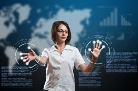 Businesswoman touching fingerprint scanner on virtual interface, futuristic technology photo