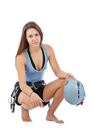 limber: Attractive woman in climbing equipment limber up in white background