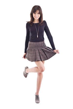 falda corta: Hermosa chica posando en minifalda. Aislado sobre fondo blanco Foto de archivo