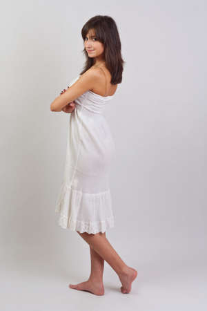 Young woman posing in a white dress photo