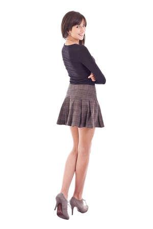 falda corta: Hermosa adolescente sonriente ni�a posando en minifalda