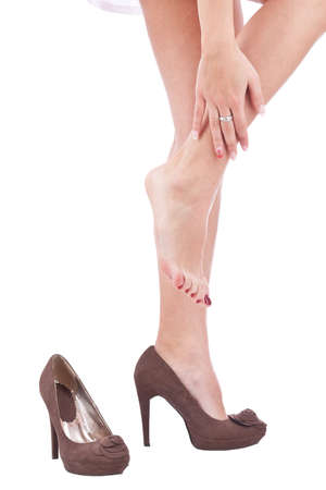 Women wearing high heels brown shoes, massaging tired legs  photo