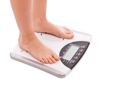 legs on scales isolated in white background Stock Photo - 13923400