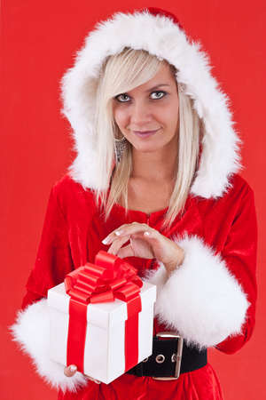 Sexy Woman with Santa Hat and Christmas Gifts  photo