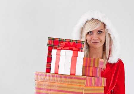 Christmas woman holding gifts wearing as Santa photo