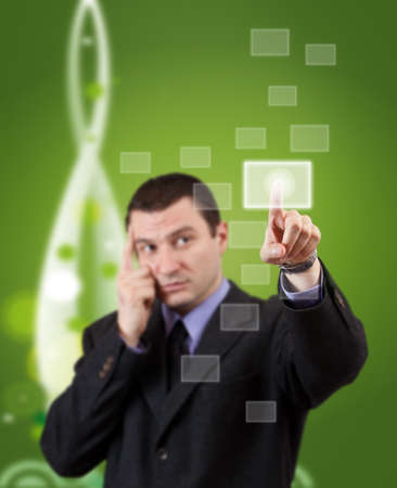 Businessman hand pressing blank button in futuristic green background  photo
