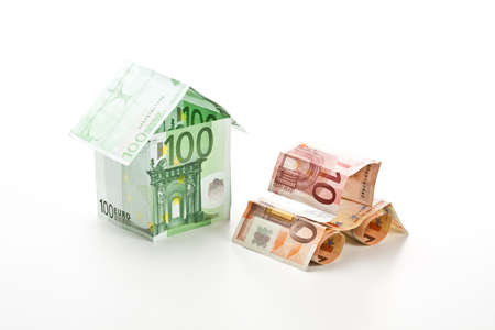 The car and the house made of euros on white background photo