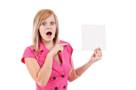 Portrait of a surprised young woman pointing at a blank card isolated over white background Stock Photo - 14742001