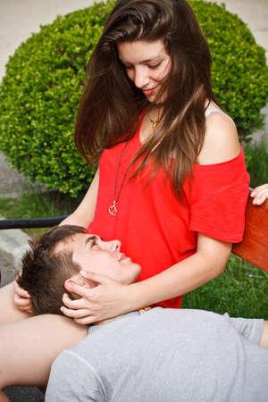 Teen boyfriend lying on his girlfriends lap
