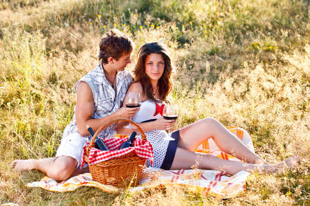 Young enamoured couple sitting on blanket photo