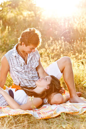 Young couple in the picnic have good time  photo
